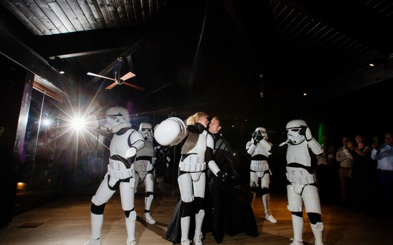 PIC BY PHIL BARRETT/MERCURY PRESS (PICTURED: BRIDE KATHRYN HOLLOWAY AND HUSBAND PHILIP WOOD REVEAL THEMSELVES AS ONE OF THE STORM TROOPERS AND DARTH VADER)A bride surprised her wedding guests by dancing as a Star Wars STORMTROOPER alongside Britains Got Talent sensations Boogie Storm for her first dance. Kathryn Holloway, 31, and Philip Wood, 37, stunned friends and family at their wedding in Granada, Spain, in September when they announced the BGT finalists as their reception entertainment. But guests of the couple were even more gobsmacked when the routine reached its finale and Kathryn whipped off her iconic white helmet to reveal SHE was one of the five Stormtrooper dancers. SEE MERCURY COPY