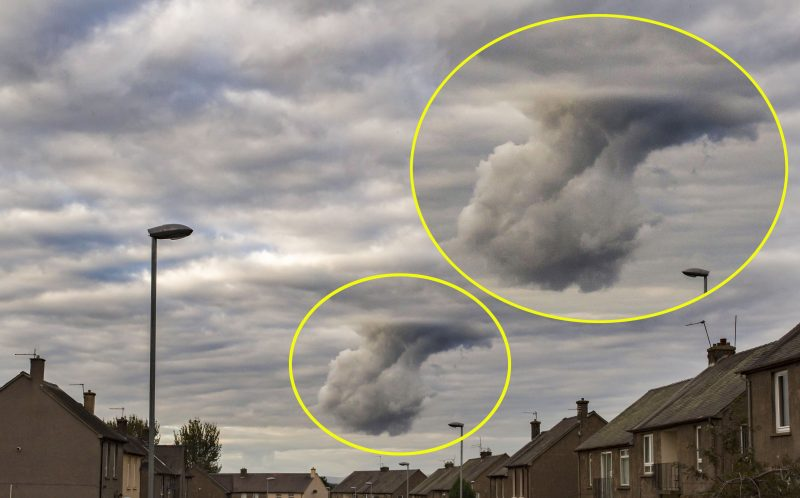 PIC BY MATT DOOGUE/ MERCURY PRESS - A dad-of-two caught a bizarre formation in the sky that has been likened to both the hand of God and even God breaking wind through the clouds.