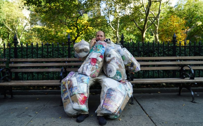 PIC BY GARY BENCHEGHIB / CATERS NEWS - Rob Greenfield hauled the equivalent of a small adult around New York City with a custom-made suit packed full of rubbish.