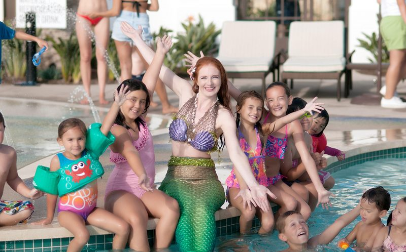 PIC FROM CATERS NEWS - A finstructor poses for her photo with her class at the Mermaid School.