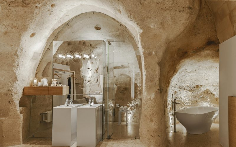 *** MANDATORY BYLINE PIC BY PIERANGELO LATERZA/ CATERS NEWS - (PICTURED: A bathroom in the Metellus Dimora hotel) - SURPRISE! This modern cave hotel will have you booking the next flight to Bari, Italy for a luxury stay in the last place you would expect.. Photographer, Pierangelo Laterza, 35 from Matera, Basilicata, Italy took his camera inside the hidden Metellus Dimora hotel- revealing a jewel in the rocks. The hotel lies in the ancient Materas Sassi district, an age-old human settlement which was declared a World Heritage Site by UNESCO in 1993. Pierangelo said: When I entered for the first time it was impressive; I did not expect so much modernity in an area built so long ago. The linearity of the furnishings, the soft colours and clean lines greet you immediately, it seems that inside you continue to breathe the same air of the exterior, the same sense of wonder and beauty. SEE CATERS COPY.