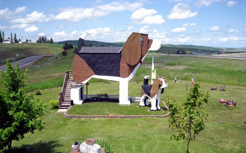 PIC BY DOG BARK PARK INN/CATERS NEWS - (PICTURED: An exterior view of the Dog Bark Park Inn in Idaho.) - British tourists love their pawsonable stay The Dog Bark Park Inn as much as the A-listers do according to the owner of the worlds biggest beagle hotel. Married artists Frances Conklin, 65 and Dennis Sullivan, 74 sketched their plans for a giant dog shaped guest house on a napkin after the success of their doggy billboard. Frances and Dennis put Idaho, USA, on the tourist map when they opened the bed and breakfast next to their art studio 16 years ago and Brits have been booking it out since. SEE CATERS COPY.
