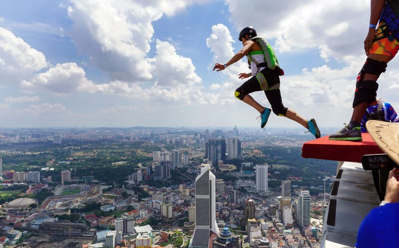 PIC BY MATT BLANK / CATERS NEWS - These base jumpers really scaled the city heights after leaping from one of the worlds tallest towers.