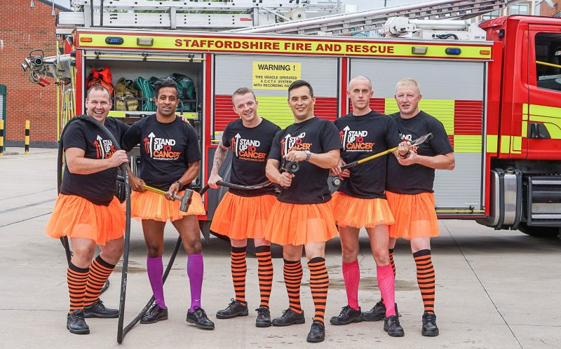 PIC BY STAND UP TO CANCER/CATERS NEWS - (PICTURED: Firefighters holding their tools dress up in tutus for Stand Up To Cancer. (L-R) Lee Savage, Zie Khalifa, Lee Pine, Tim Chan, Jonathan Jackson and Watch Manager Chris Elkin in front of a Staffordshire fire engine.) - Staffordshire firefighters swapped boots for ballet gear in a tutu-daring video to raise money for Stand Up To Cancer. Members of Blue Watch from Hanley fire station switched their usual firefighting gear for short orange tutus and silly stockings in an act of clothing rebellion for Stand Up To Cancers stand out challenge. The cheeky firefighters took the challenge one step further when they showed off their best ballet moves to the well known Swan Lake classic - Dance of the Sugar Plum Fairy. Paula Young Cancer Research UKs spokesperson for Staffordshire, said: Wed like to thank the members of Blue Watch for going the extra mile and standing up to cancer in style. What better way to get our message across than to make people laugh?Stand Up To Cancer raises money to speed up breakthroughs from the lab to the patients who need them right now. With support, we can continue to fund vital research to get new and better treatments to cancer patients faster. Its time to join the rebellion against cancer. Stand up, stand out and help save lives. ENDS
