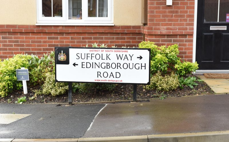 PIC BY MIKEY JONES / CATERS NEWS - (PICTURED the sign ) - A bizarre misspelling of a road sign in a Derbyshire Village has left housing developer red-faced. The miss spelt Edingborough Road sign, that was put up in Church Gresley a week ago by David Wilson Homes, was erected to make it clearer to motorists where Edinburgh Road finished and Suffolk Way began. And it not the first time designers have been left embarrassed by a road sign in the area. In August last year, Derbyshire County Council put up signs near the A38 pointing motorists to Eggington when in fact the correct spelling of the village is Egginton. SEE CATERS COPY