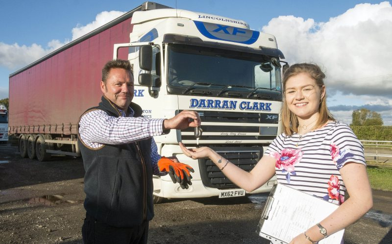 PIC BY PAUL DAVID DRABBLE/ CATERS NEWS - Amy Clark teenage truck driver Female student drives trucks while home from university receives truck keys from Dad Darran Clark.