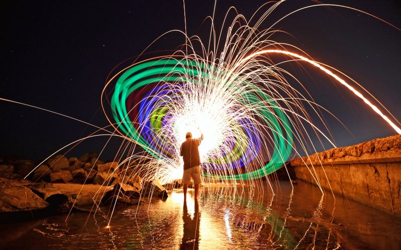 PIC BY CHRIS MATTHEW BRADY/CATERS NEWS - Chris Brady creates an amazing colourful light display called a Catherine Wheel in California.