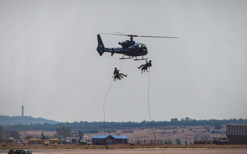 PIC BY Paramount Group Anti-Poaching and K9 Academy/CATERS NEWS - Alpha and Giant rapeling with their handlers from a Gazelle helicopter.