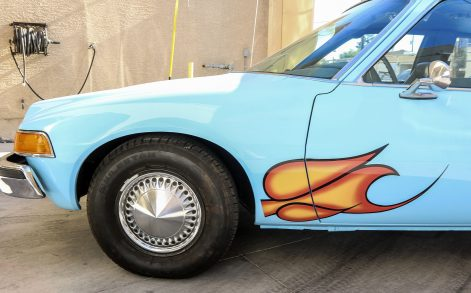 PIC FROM CATERS NEWS - (PICTURED: A side view of the Pacer used in the film, Waynes World.) - Bismallah! The famous AMC Pacer from the 1992 smash hit film Waynes World has been let go at auction for 7,400 (30,734). The car rose to prominence during a scene in which main characters, Wayne Campbell and Garth Algar, belt out a head-banging rendition of Queens famous Bohemian Rhapsody. The film finished 1992 as one of the top grossing films of that year, and caused the rock ballad to rocket to number two in the charts, 17 years after it was first released. A standard AMC Pacer would be expected to sell for no more than ,000. Original modifications made for the film are the baby blue paint and the flames around the wheel arches, a hole in the roof for the famous liquorice dispenser, new rear wheelhouses to fit speaker boxes, and a cup dispenser in the inner dashboard. Tow hooks and steel plates were also welded to the car for filming and camera supports. The studio also purposefully mismatched the wheel combination of chrome spoked wheels in the rear and standard hubcaps in the front. These features have been kept during the cars extensive restoration. SEE CATERS COPY.