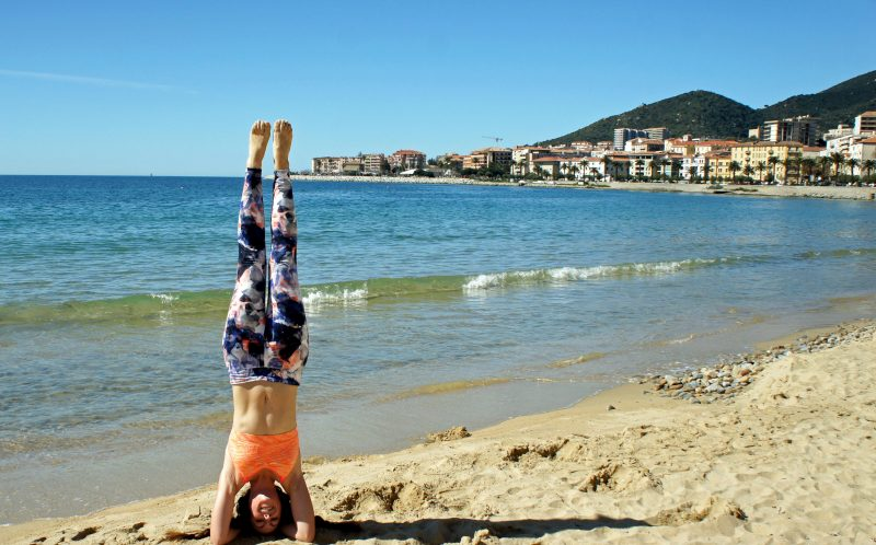 PIC BY AMY MALOON/CATERS NEWS - (PICTURED: Amy does a headstand in Ajaccio, France.) - If this amazing video of yoga in the worlds most spectacular locations does not inspire you to become at one with nature- nothing will. Acupuncturist, Yoga Instructor, and an Intuitive Healer, Amy Maloon, 31, from San Francisco, CA, started practicing yoga as a teenager in an attempt to become more flexible for dancing. Amy filmed her yoga in 26 countries while working as an acupuncturist on a cruise ship and cannot wait to take her yoga retreats on a similar journey next year. SEE CATERS COPY.