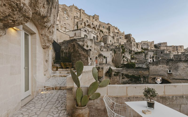 *** MANDATORY BYLINE PIC BY PIERANGELO LATERZA/ CATERS NEWS - (PICTURED: The Terrece of the Metellus Dimora hotel overlooking the Ancient city) - SURPRISE! This modern cave hotel will have you booking the next flight to Bari, Italy for a luxury stay in the last place you would expect.. Photographer, Pierangelo Laterza, 35 from Matera, Basilicata, Italy took his camera inside the hidden Metellus Dimora hotel- revealing a jewel in the rocks. The hotel lies in the ancient Materas Sassi district, an age-old human settlement which was declared a World Heritage Site by UNESCO in 1993. Pierangelo said: When I entered for the first time it was impressive; I did not expect so much modernity in an area built so long ago. The linearity of the furnishings, the soft colours and clean lines greet you immediately, it seems that inside you continue to breathe the same air of the exterior, the same sense of wonder and beauty. SEE CATERS COPY.