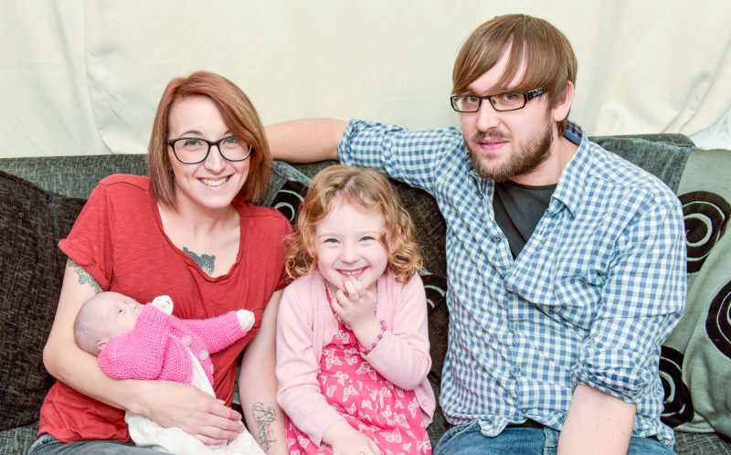 PIC BY MICHAEL SCOTT/CATERS NEWS - (PICTURED: Family photograph with mother and father Rhiannon (29) and Fane Shades (30) and Alexandra Cooper (4) and Emily Shades who is 16-weeks-old.) - A baby who was saved by a sandwich bag after weighing just 560 GRAMS has finally been allowed home. Rhiannon Shades, 29, from Bedford, was terrified when she went into labour at 24 weeks pregnant - after being born naturally in her amniotic sac , tiny Emily was placed into a sandwich bag to keep her warm. She needed eight blood transfusions and was placed on 24/7 oxygen to help her breathe. But against the odds, and after three and a half months in neonatal care, Emily was allowed home last Tuesday (October 18) - one day before her due date. Rhiannon and her partner, Fane Henderson, 30, couldnt be prouder of their daughter and have since started blogging to help other parents. SEE CATERS COPY.