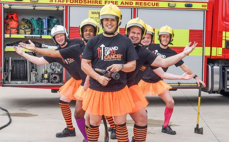 PIC BY STAND UP TO CANCER/CATERS NEWS - (PICTURED: All for a good cause, Staffordshire firefighters Chris Elkin, Zie Khalifa, Tim Chan, Lee Savage, Lee Pine, Jonathan Jackson line up in tutus to raise money for Stand Up To Cancer.) - Staffordshire firefighters swapped boots for ballet gear in a tutu-daring video to raise money for Stand Up To Cancer. Members of Blue Watch from Hanley fire station switched their usual firefighting gear for short orange tutus and silly stockings in an act of clothing rebellion for Stand Up To Cancers stand out challenge. The cheeky firefighters took the challenge one step further when they showed off their best ballet moves to the well known Swan Lake classic - Dance of the Sugar Plum Fairy. Paula Young Cancer Research UKs spokesperson for Staffordshire, said: Wed like to thank the members of Blue Watch for going the extra mile and standing up to cancer in style. What better way to get our message across than to make people laugh?Stand Up To Cancer raises money to speed up breakthroughs from the lab to the patients who need them right now. With support, we can continue to fund vital research to get new and better treatments to cancer patients faster. Its time to join the rebellion against cancer. Stand up, stand out and help save lives. ENDS