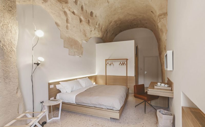 *** MANDATORY BYLINE PIC BY PIERANGELO LATERZA/ CATERS NEWS - (PICTURED: One of the bedrooms in the Metellus Dimora hotel) - SURPRISE! This modern cave hotel will have you booking the next flight to Bari, Italy for a luxury stay in the last place you would expect.. Photographer, Pierangelo Laterza, 35 from Matera, Basilicata, Italy took his camera inside the hidden Metellus Dimora hotel- revealing a jewel in the rocks. The hotel lies in the ancient Materas Sassi district, an age-old human settlement which was declared a World Heritage Site by UNESCO in 1993. Pierangelo said: When I entered for the first time it was impressive; I did not expect so much modernity in an area built so long ago. The linearity of the furnishings, the soft colours and clean lines greet you immediately, it seems that inside you continue to breathe the same air of the exterior, the same sense of wonder and beauty. SEE CATERS COPY.
