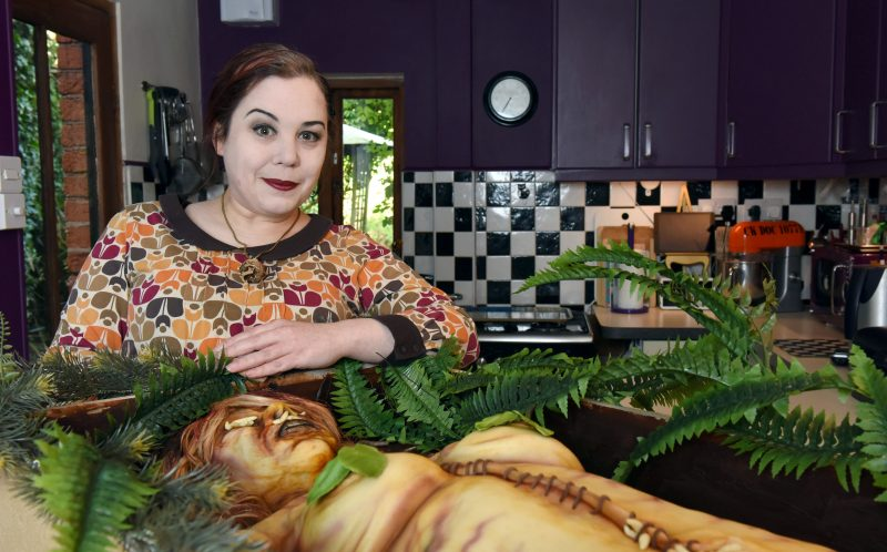 PIC BY MIKEY JONES / CATERS NEWS - Annabel De Vetten, 45 from Birmingham, AKA Annabel Lecter stands with her realistic decomposing corpse cake.