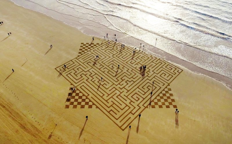 PIC FROM CATERS NEWS (PICTURED: A aerial view of amazing sand art, which consists of geometrical shapes created by talented artist, Julian Richardson at Brean Down in Somerset. ) - These incredible photos show the A-MAZE-ING results of an artists race against time and tides to create sand art. Seen from above, the beautiful patterns stretch of vast swathes of the beach, before the waves roll in reclaim the sand canvas as their own. The artworks were created by Wiltshire artist Julian Richardson, using little more than a rake. Since 2013 he has created 45 sand artworks across the south and west of England, and has even worked with the National Trust. Julian normally works at Brean Down in Somerset, as the Bristol channel has one of the worlds largest tidal ranges and the rocky headland offers a 300ft view over the beach.SEE CATERS COPY