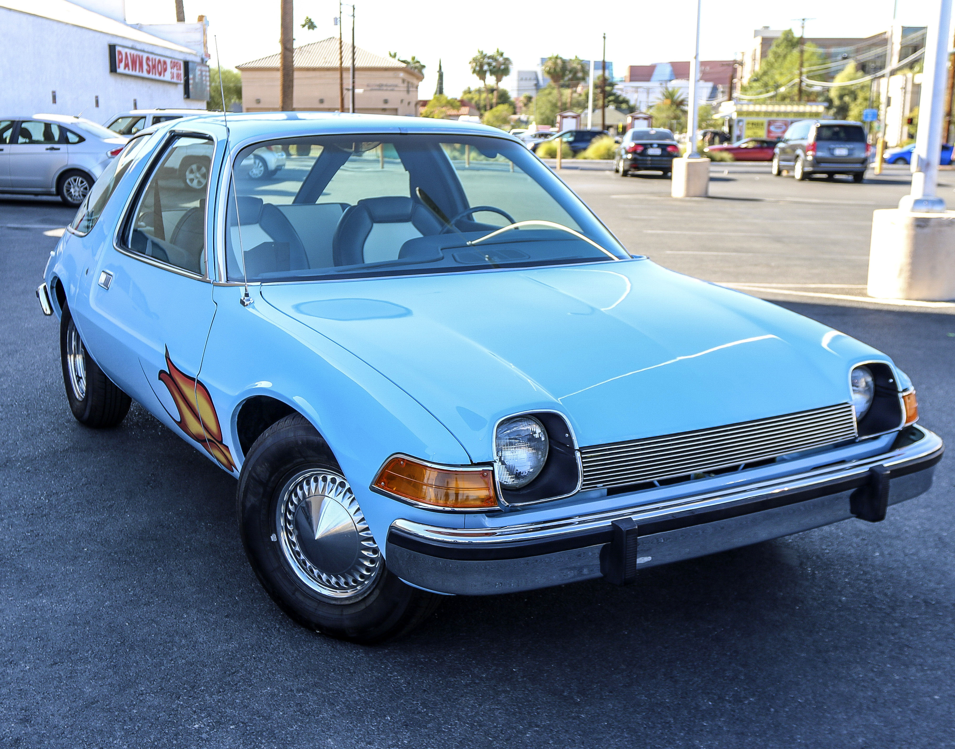 PIC FROM CATERS NEWS - (PICTURED: The AMC Pacer from the film, Waynes World. ) - Bismallah! The famous AMC Pacer from the 1992 smash hit film Waynes World has been let go at auction for 7,400 (30,734). The car rose to prominence during a scene in which main characters, Wayne Campbell and Garth Algar, belt out a head-banging rendition of Queens famous Bohemian Rhapsody. The film finished 1992 as one of the top grossing films of that year, and caused the rock ballad to rocket to number two in the charts, 17 years after it was first released. A standard AMC Pacer would be expected to sell for no more than ,000. Original modifications made for the film are the baby blue paint and the flames around the wheel arches, a hole in the roof for the famous liquorice dispenser, new rear wheelhouses to fit speaker boxes, and a cup dispenser in the inner dashboard. Tow hooks and steel plates were also welded to the car for filming and camera supports. The studio also purposefully mismatched the wheel combination of chrome spoked wheels in the rear and standard hubcaps in the front. These features have been kept during the cars extensive restoration. SEE CATERS COPY.