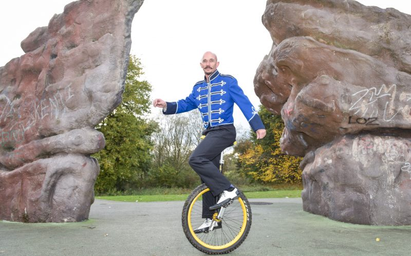 PIC BY MICHAEL SCOTT/CATERS NEWS - Family Circus performer, Neil Travis rides his off-road unicycle in a park in Stoke-on-Trent.