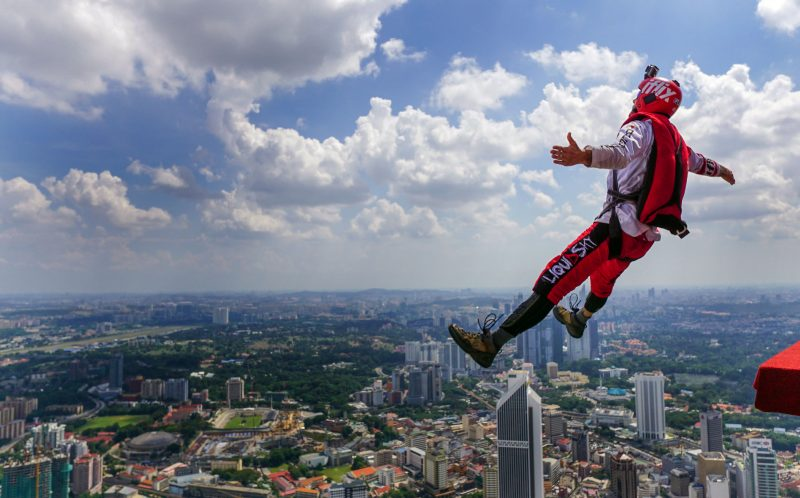 PIC BY MATT BLANK / CATERS NEWS - The moment one of the base jumpers leaped off the KL Tower.