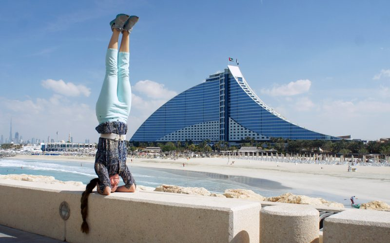 PIC BY AMY MALOON/CATERS NEWS - (PICTURED: Amy Maloon does a headstand in Jumeirah Beach Hotel in Dubai.) - If this amazing video of yoga in the worlds most spectacular locations does not inspire you to become at one with nature- nothing will. Acupuncturist, Yoga Instructor, and an Intuitive Healer, Amy Maloon, 31, from San Francisco, CA, started practicing yoga as a teenager in an attempt to become more flexible for dancing. Amy filmed her yoga in 26 countries while working as an acupuncturist on a cruise ship and cannot wait to take her yoga retreats on a similar journey next year. SEE CATERS COPY.