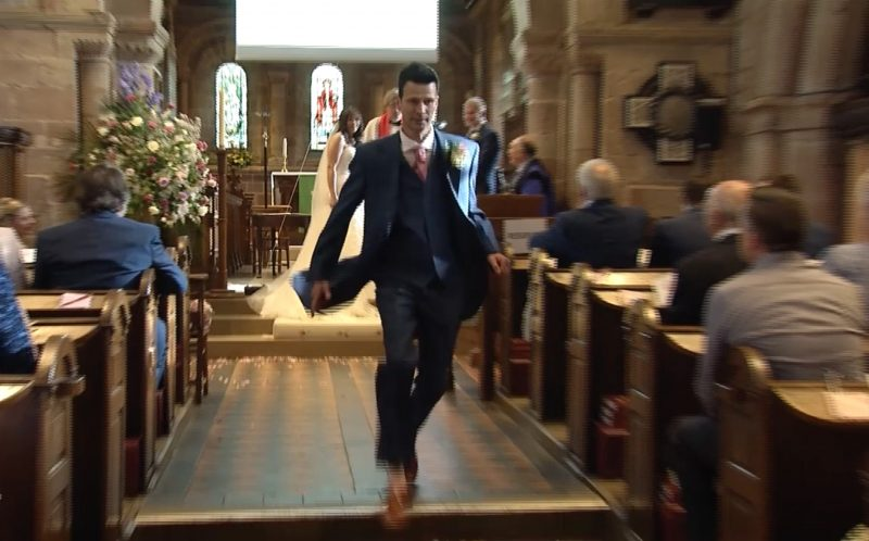 PIC FROM CATERS NEWS - (PICTURED: Stuart Kettle leaves his wife to be Vicky at the altar as part of an elaborate prank.) - A groom left his bride standing at the altar during their wedding ceremony and dashed out of the church as part of an elaborate forgotten the rings prank. The church wedding appeared to be going off without a hitch, until half-way through the ceremony, trickster groom Stuart Kettell fooled his bride, best man and wedding guests into thinking hed forgotten the rings. Believing the wedding couldnt go ahead without them, guests watched in shock as Stuart ran out of the church leaving his bride-to-be Vicky, and best man Robert Kettell, standing at the altar. But as soon as the church door slammed behind him a screen dropped down at the front of the church showing a pre-recorded video of Stuart making an epic journey home to retrieve the rings. SEE CATERS COPY.