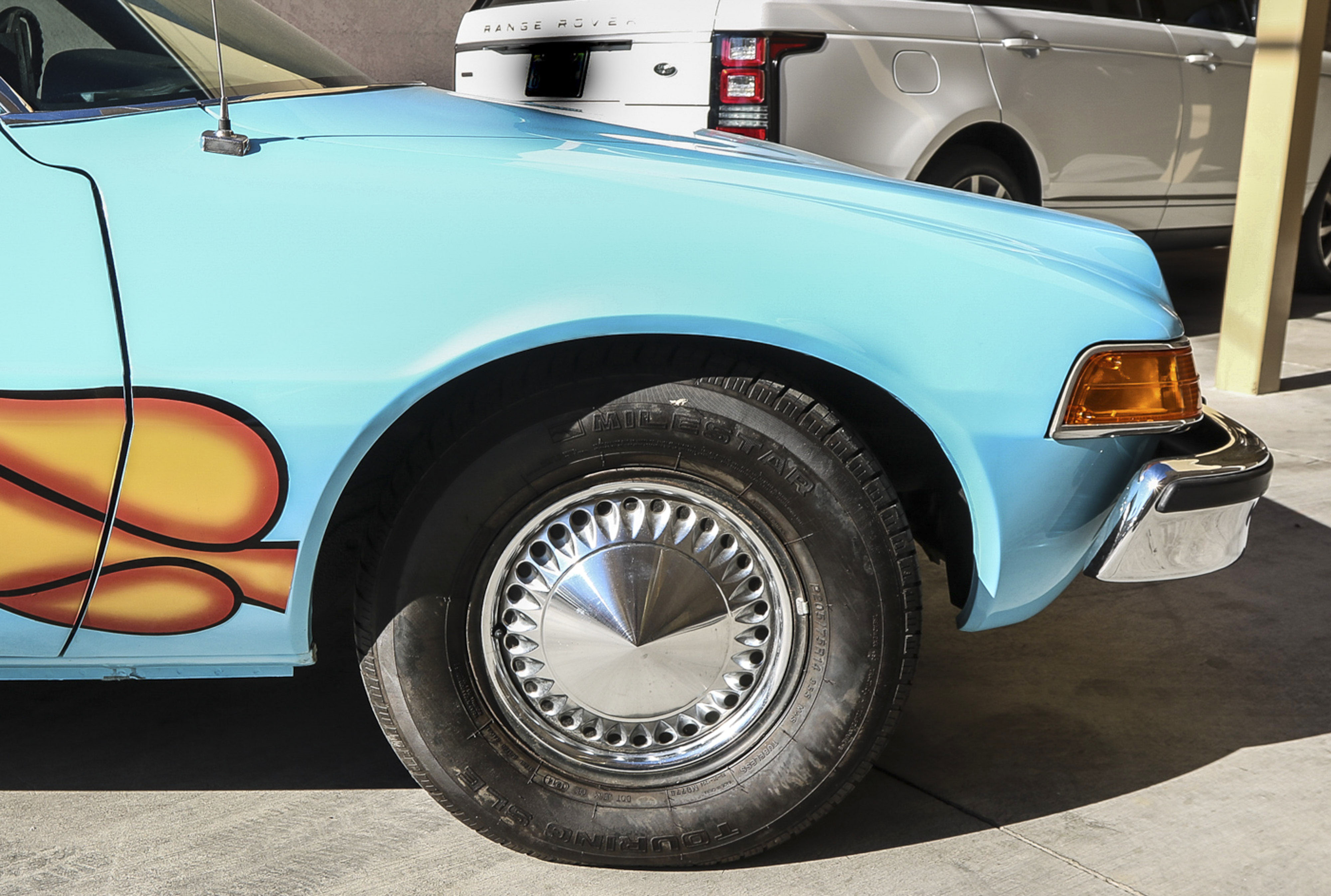 PIC FROM CATERS NEWS - (PICTURED:  A view of the Pacer from the film, Waynes World.) -Bismallah! The famous AMC Pacer from the 1992 smash hit film Waynes World has been let go at auction for 7,400 (30,734). The car rose to prominence during a scene in which main characters, Wayne Campbell and Garth Algar, belt out a head-banging rendition of Queens famous Bohemian Rhapsody. The film finished 1992 as one of the top grossing films of that year, and caused the rock ballad to rocket to number two in the charts, 17 years after it was first released. A standard AMC Pacer would be expected to sell for no more than ,000. Original modifications made for the film are the baby blue paint and the flames around the wheel arches, a hole in the roof for the famous liquorice dispenser, new rear wheelhouses to fit speaker boxes, and a cup dispenser in the inner dashboard. Tow hooks and steel plates were also welded to the car for filming and camera supports. The studio also purposefully mismatched the wheel combination of chrome spoked wheels in the rear and standard hubcaps in the front. These features have been kept during the cars extensive restoration. SEE CATERS COPY.