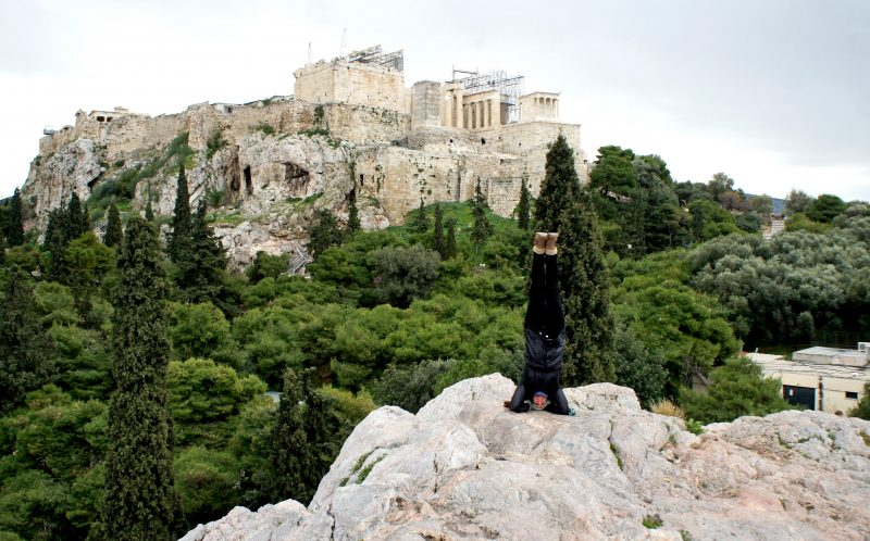PIC BY AMY MALOON/CATERS NEWS - (PICTURED: Amy does a headstand in Athens, Greece.) - If this amazing video of yoga in the worlds most spectacular locations does not inspire you to become at one with nature- nothing will. Acupuncturist, Yoga Instructor, and an Intuitive Healer, Amy Maloon, 31, from San Francisco, CA, started practicing yoga as a teenager in an attempt to become more flexible for dancing. Amy filmed her yoga in 26 countries while working as an acupuncturist on a cruise ship and cannot wait to take her yoga retreats on a similar journey next year. SEE CATERS COPY.