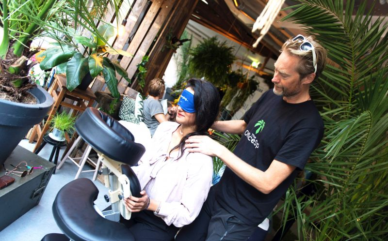 PIC FROM CATERS NEWS - A guest receiving a massage inside the Hangover Bar.