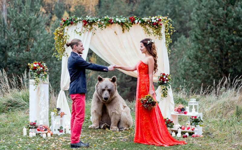 PIC BY OLGA BARANTSEVA / CATERS NEWS - Denis and Nelya get married with a bear acting as their registrar.