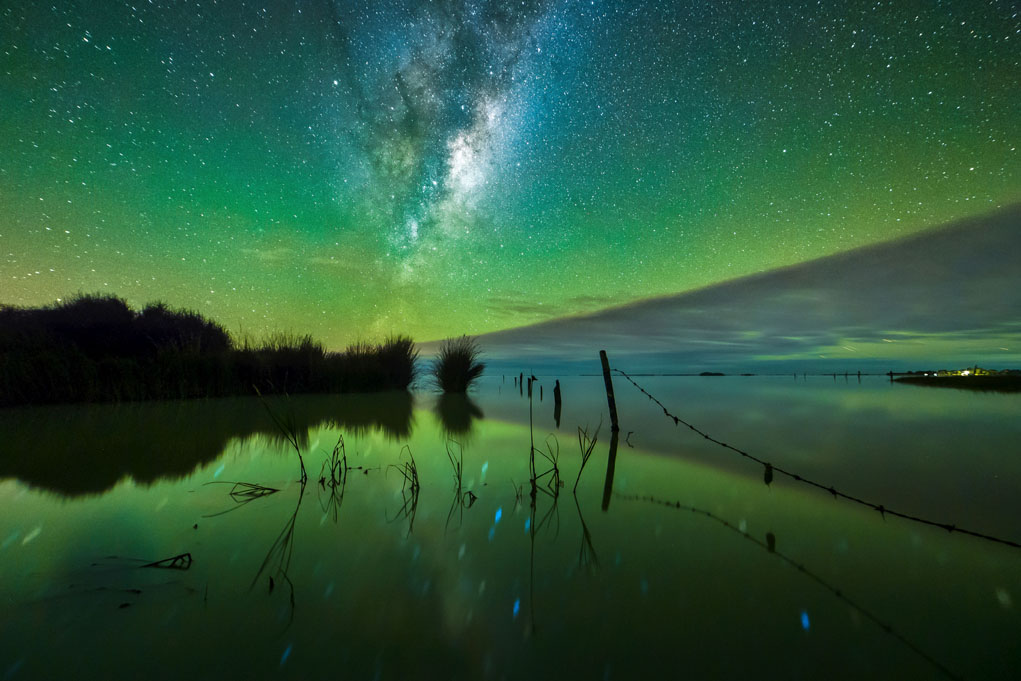 PIC BY PAUL WILSON/CATERS NEWS- (PICTURED: Excited oxygen atoms in the earths atmosphere give the sky a green glow over Banks Peninsula, New Zealand.) - Talk about a starry night! These mind-blowing images of stunning nightscapes will take your breath away. The incredible shots capture the true beauty of the nights sky, lit up in a kaleidoscope of colour, twinkling with millions of stars or adorned by the Milky Way. Paul, 29, is a wedding photographer by day but at night he pursues his passion for astrophotography. SEE CATERS COPY