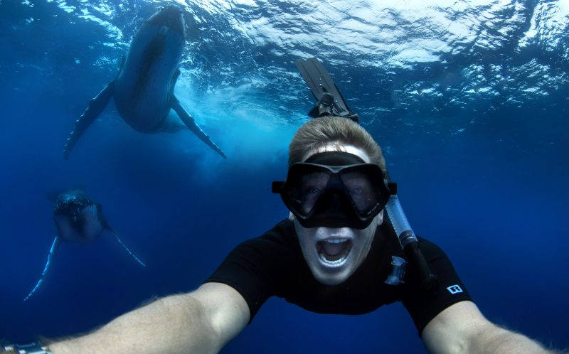 PIC BY CRAIG PARRY/ CATERS NEWS - Craig taking a selfie with the whales.