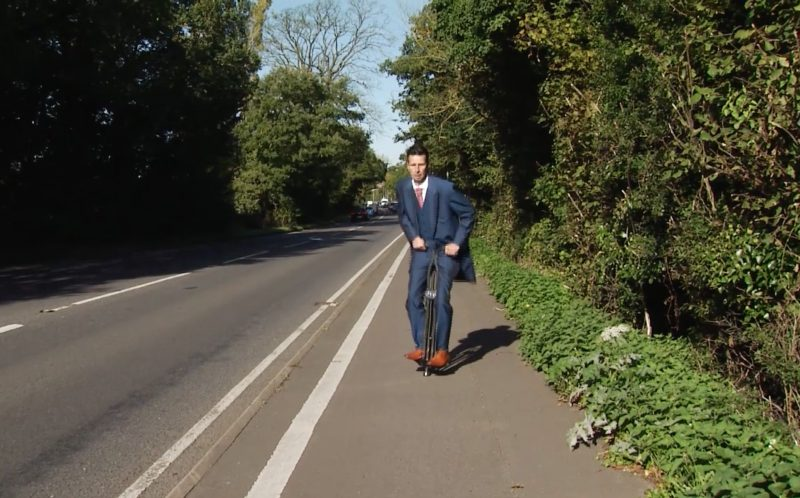 PIC FROM CATERS NEWS - (PICTURED: A video plays showing Stuarts Epic journey to get the forgotten rings. Stuart rides a pogo stick down a country lane.) - A groom left his bride standing at the altar during their wedding ceremony and dashed out of the church as part of an elaborate forgotten the rings prank. The church wedding appeared to be going off without a hitch, until half-way through the ceremony, trickster groom Stuart Kettell fooled his bride, best man and wedding guests into thinking hed forgotten the rings. Believing the wedding couldnt go ahead without them, guests watched in shock as Stuart ran out of the church leaving his bride-to-be Vicky, and best man Robert Kettell, standing at the altar. But as soon as the church door slammed behind him a screen dropped down at the front of the church showing a pre-recorded video of Stuart making an epic journey home to retrieve the rings. SEE CATERS COPY.