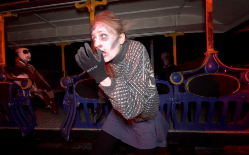 PIC BY THORPE PARK/CATERS NEWS - (PICTURED: A woman dressed as a sleeper comes towards the camera.) - Watch beautiful theme park goers scream hysterically as they dare to walk through the UKs scariest train station. Thorpe Park guests, brave enough to enter Platform 15, have been getting the fright of their lives at the resorts latest outdoor, live-action scare maze. The side-splitting footage of zombie-like sleepers jumping out the woods at a group of nervous young women is priceless.SEE CATERS COPY.