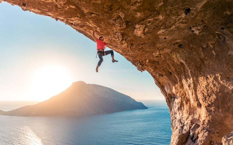 PIC BY KIERAN DUNCAN/CATERS NEWS - (PICTURED: A daredevil climber scales a rockface against the beautiful backdrop of Kalymnos, Greece.) - These frightening photos of daring rock climbers pushing their grip to the limit have the most stunning coastal backdrop. Freelance filmmaker and photographer, Kieran Duncan, 26 years old, living in Dundee, Scotland captured the action at the annual Kalymnos Climbing Festival. SEE CATERS COPY.
