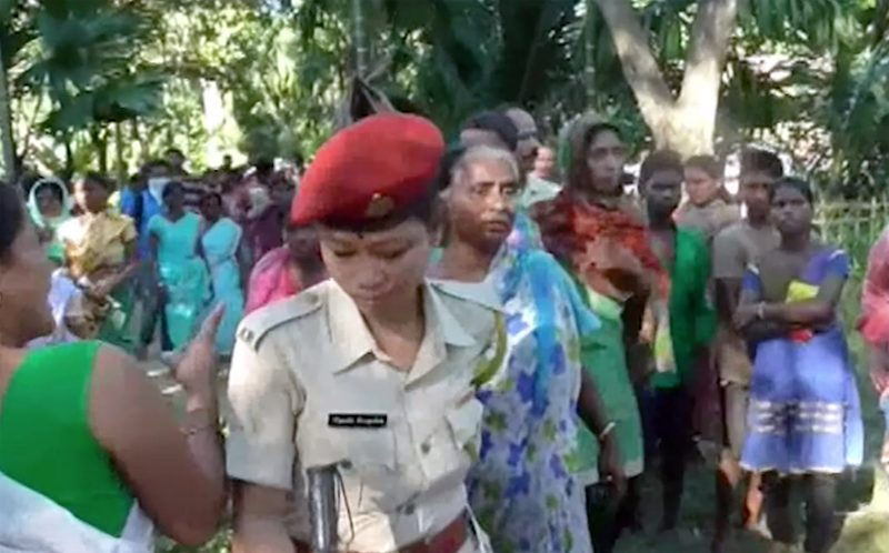 PIC FROM CATERS NEWS - (PICTURED: Police in the jungle with villagers) - Police are investigating whether a four-year-old girl was sacrificed by witch doctors who were trying to locate a neighbours missing mobile phone. The body of little Sunu Godba was found on Monday with her head cut off and hands and legs removed in a jungle near her home. She has been reported missing on October 24 from a village in upper Assam in northeast India which is infamous for witchcraft practices. But police are now hunting two witch doctors who were employed by Sunus neighbour Hanuman Bhumi to find his daughters mobile phone considered a luxury in the region. SEE CATERS COPY.