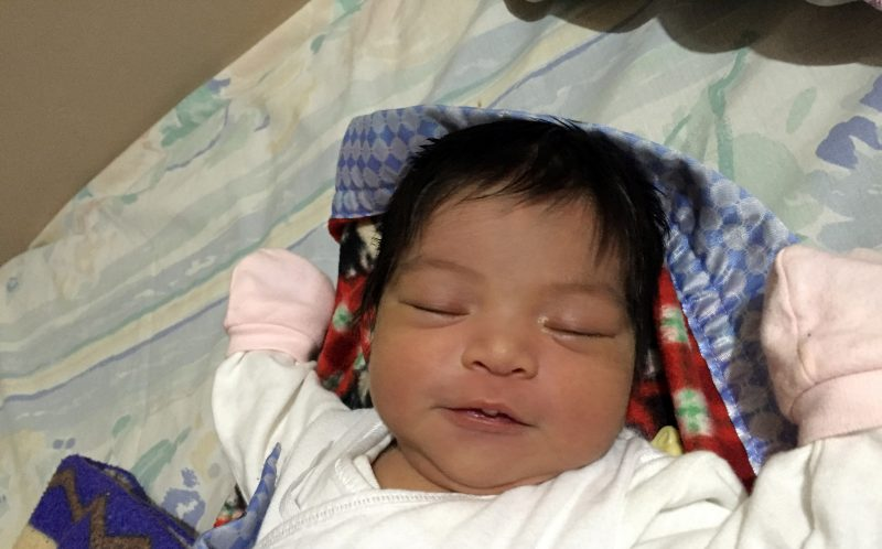 PIC FROM CATERS NEWS - (PICTURED: Baby Heather takes a nap 3 days old.) - An adorable tot gets stopped for selfies and is accused of wearing a WIG. Little Heather P. Serna, from Singapore, has so much hair her mum struggles to see over the bouffant when carrying her down the stairs. Nina P. Serna, 33, says her toddlers hair stood six inches high when she was just months old but now refuses to wear a headband. Bubbly Heather, aged 21 months, loves posing for photos and having her hair blow-dryed. The tot was born with a full head of hair but parents Nina and husband Henry, also 33, didnt think Heathers head of hair was anything special until passersby started stopping the couple. SEE CATERS COPY.