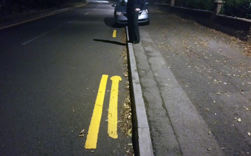 PIC BY AD OVERBURY/ CATERS NEWS - (PICTURED: Gaps inbetween the yellow lines where the parked cars used to be) - Bungling council workers have painted double yellow lines around PARKED cars. Red faced bosses insist the lines, in Tile Hill, Coventry, are common practice - saying its normal to paint around obstructions. But the patchy lines, on Conway Avenue and Duggins Lane, have been branded a joke by furious residents. The lines first appeared on Monday 31 October and are still incomplete, with one surrounding a silver Nissan Primera. SEE CATERS COPY.
