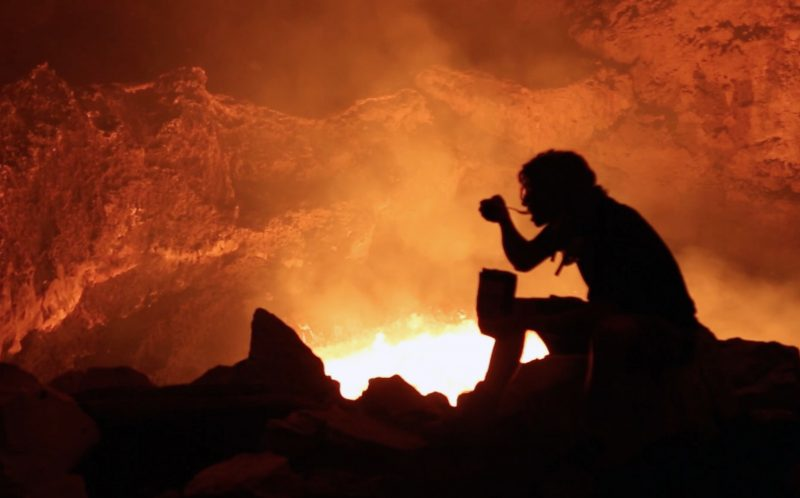 PIC BY CHRIS HORSLEY/ CATERS NEWS - Chris Horsley sat by the volcano eating.