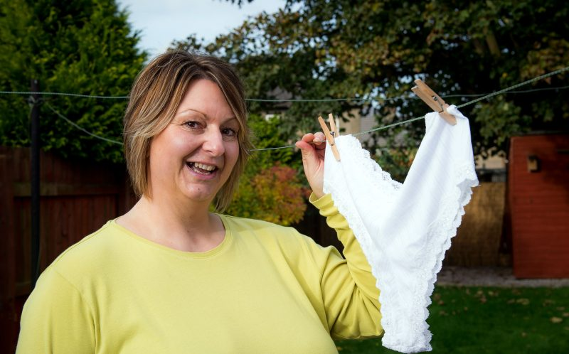 PIC BY FRASER BAND / CATERS NEWS - (PICTURED: Ruth Webster, 46, from Fife.) - A super slimmer is flaunting her weight loss by hanging her shrinking knickers on the washing line after decades of folding them in half. Ruth Webster, 46, from Fife, used to fold her gigantic, size 32, pants in half before putting them out on the line in a bid to deceive her neighbours. For years Ruth battled with her weight until she was finally diagnosed with a binge eating disorder last year which she used as a catalyst to start shedding the pounds for good. After giving up takeaways and sugary snacks, Ruth has dropped seven stone in just ten months - taking her from 26 to 19 stone and shrinking her hips by 20 inches. Ruth started Joe Wicks 90 Day SSS plan, and despite wanting to lose more weight she claims that her undies are proof that the plan works. SEE CATERS COPY.