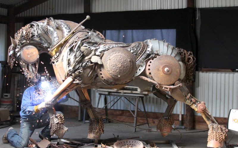 PIC BY JOHN LOPEZ/ CATERS NEWS - (PICTURED: John Lopez working on a shire horse) - They say one mans junk is another mans treasure and this certainly rings true for this artist who creates incredible sculptures of horses from scrap metal. The large and intricate sculptures are the work of artist John Lopez who welds the pieces from metal and old farm machinery. John, 43, from South Dakota, USA, once enjoyed a career in bronze sculpting but now uses his talents to create his own artworks. His collection includes a number of life-size horses and buffalo with each on taking up to six months to complete. - SEE CATERS COPY