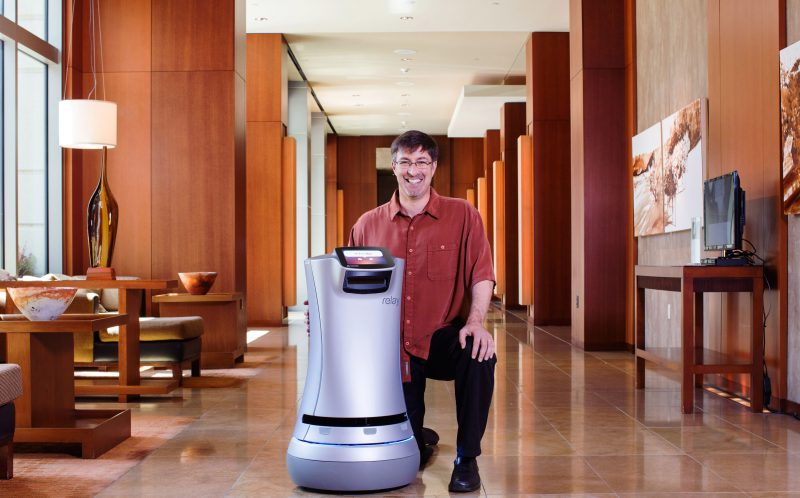 PIC BY SAVIOKE / CATERS NEWS - (PICTURED: Relay and Steve Cousins) - A luxury Los Angeles complex is offering ROBOT butlers - and could cost up to 5,000 (18,890) a month. Ten Thousand a 40-story tower in Beverly Hills, California offers first-of-their-kind tech. The robot from Savioke named CHARLEY is the first in a residential building.It can deliver packages, meals and beverages right to the door and can even operate elevators on its own.Residents will be able to order delivery items via iPad Mini 4s, presented to each residence upon move-in. A team of butlers will receive the requests and place the items inside CHARLEYs secure interior compartment for delivery. SEE CATERS COPY
