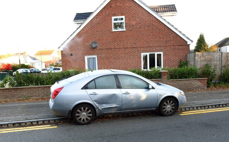 PIC FROM CATERS NEWS - (PICTURED: The yellow lines painted around a parked car) - Bungling council workers have painted double yellow lines around PARKED cars. Red faced bosses insist the lines, in Tile Hill, Coventry, are common practice - saying its normal to paint around obstructions. But the patchy lines, on Conway Avenue and Duggins Lane, have been branded a joke by furious residents. The lines first appeared on Monday 31 October and are still incomplete, with one surrounding a silver Nissan Primera. SEE CATERS COPY.