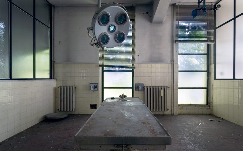 PIC BY ROMAN ROBROEK/ CATERS NEWS - (PICTURED: The examination table) - Eerie photos of an old animal testing facility in Italy are as unsettling as you would expect. Urban-obsessed photographer and ICT manager, 29-year-old Roman, from the Netherlands visited the abandoned animal testing facility. Roman said: The location had a horrible mood inside and I didnt really enjoy my time there. It was very sad to see the cages for example where animals must have suffered horribly. About five years ago the last employees that worked here, left. The company was bought by a Swiss giant in the industry and they decided to move the facility. SEE CATERS COPY.