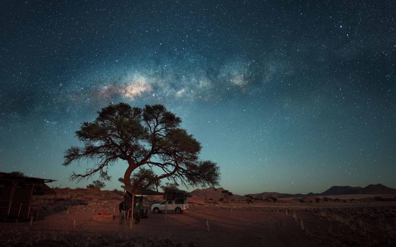 PIC BY PIETRO OLIVETTA/ CATERS NEWS - (PICTURED: The Namibian milky way sky) - Starry, starry night! These explorers set up camp under stars so bright you can read a BOOK in the dead of night. Photographer Pietro Olivetta, from Italy, came across the stunning camping spot whilst exploring with pals in Namibia. The make-shift camp was lit up by thousands of bright stars shining down from the Milky Way, giving the group a striking view of the twinkling sky. The glowing stars shone so brightly that the group, who stayed at the camp for four weeks, could even settle down to read a book after the sun went down. SEE CATERS COPY.