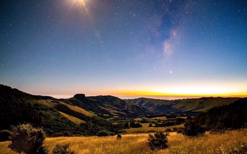PIC BY PAUL WILSON/CATERS NEWS - (PICTURED: A gorgeous timelapse image of the stars appearing in the daytime in New Zealand.) - This stunning timelapse footage showing beautiful New Zealand scenery will take your breath away. It was created by photographer Paul Wilson, from Christchurch, who sat up all night to put together the video - to bring a smile to peoples faces following the horrific earthquake. The serene video shows calm blue waters, rolling hills and dramatic mountain landscapes lit up by stars across New Zealands south island, including Tumbledown Bay near the quakes centre. SEE CATERS COPY.