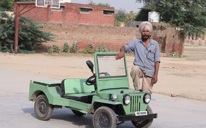 PIC FROM CATERS NEWS - (PICTURED: Bawar Singh and his tiny Jeep.) - A 60-year-old pensioner who never went to school has built a miniature jeep which could help the physically challenged. Bawar Singh, who lives in the north Indian state of Punjab, built the innovative vehicle in the backyard of his house and spent the last two years perfecting the design. Singh, who starting working in a car repair shop when he was 18, says he got the idea to built a high performance miniature car in 1975 after a physically challenged person asked him to build an extra set of wheels for his scooter. SEE CATERS COPY.