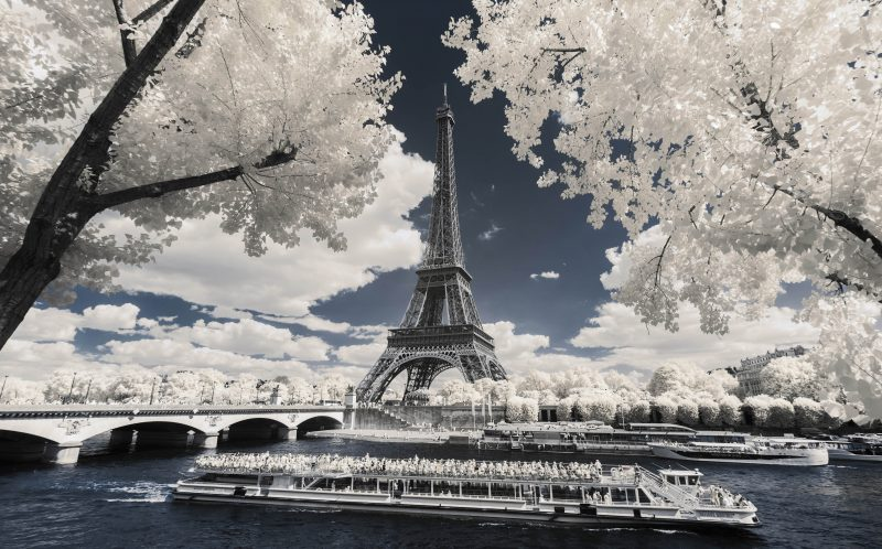PIC BY PIERRE-LOUIS FERRER/MERCURY PRESS (PICTURED: THE EIFFEL TOWER IN PARIS TAKEN USING AN INFRA RED CAMERA) Paris is usually recognised by its bright lights, historic monuments and world-class cuisine, but a French photographer has captured the city from a different all-white perspective.   Pierre-Louis Ferrer, from Paris, has snapped iconic landmarks including the Eiffel Tower, Notre-Dame and Sacr Coeur and produced breathtaking shots using infrared photography. Although digital cameras are naturally able to record infrared and UV light, they are stopped from doing this by a hot mirror filter which transforms it into a normal picture. By removing this filter and using a special infrared filter Pierre-Louis can capture his surroundings in glorious shades of white that would otherwise be invisible to the naked eye. SEE MERCURY COPY