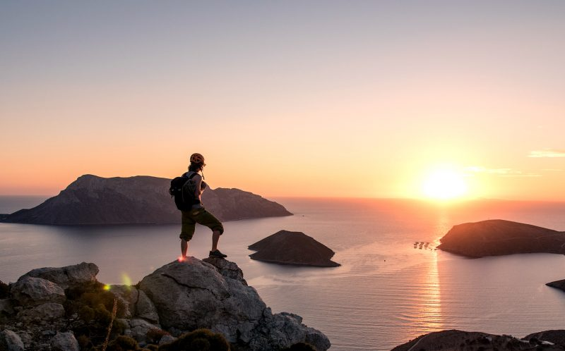 PIC BY KIERAN DUNCAN/CATERS NEWS - (PICTURED: One of the climbers looks out towards the horizon as the sunt sets in Kalymnos.) - These frightening photos of daring rock climbers pushing their grip to the limit have the most stunning coastal backdrop. Freelance filmmaker and photographer, Kieran Duncan, 26 years old, living in Dundee, Scotland captured the action at the annual Kalymnos Climbing Festival. SEE CATERS COPY.