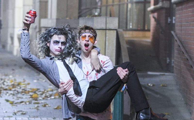 PIC BY MICHAEL SCOTT/CATERS NEWS - (PICTURED: A lad carries a mate down Broad Street in fancy dress during Halloween celebrations in Birmingham.)It was nightmare on Broad Street last night as thousands of revellers hit the streets for Halloween. Party-goers in Birmingham, West Mids, could be seen collapsed on the floor as paramedics tended to them while another appeared to urinate against a wall. Another guy, dressed in camouflage, was violently sick on the street and a girl was also crouched over vomiting as her friend comforted her. Students went all out with their fancy dress as part of the Nightmare on Broad Street event, which saw over 4,500 people hit the citys infamous strip.