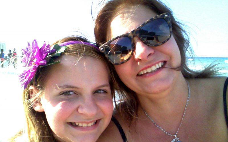 PIC FROM MERCURY PRESS (PICTURED: MELISSA KURTZ, 48, AND HER DAUGHTER HARPER, 13)A mum claims her daughter caught the moment a child ghost hitchhiked a ride in their car and experts believe it was an accident victim warning her to wear a seatbelt.Melissa Kurtz, 48, was driving her daughter Harper to a beauty pageant when the 13-year-old became bored on the 45-minute journey began taking selfies.However later the mum-of-two spotted the ghostly face a young boy lurking on the back seat appearing to reach towards Harper despite no one else being in the car with them.Researching the stretch of road they were travelling on, Melissa discovered that the apparitions appearance coincided with the anniversary of a death in a road accident that she believes was possibly the same child. SEE MERCURY COPY
